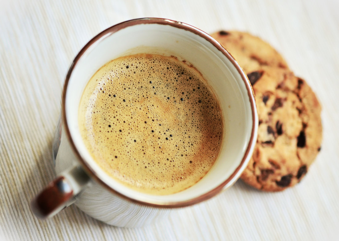 a hot drink with cookies