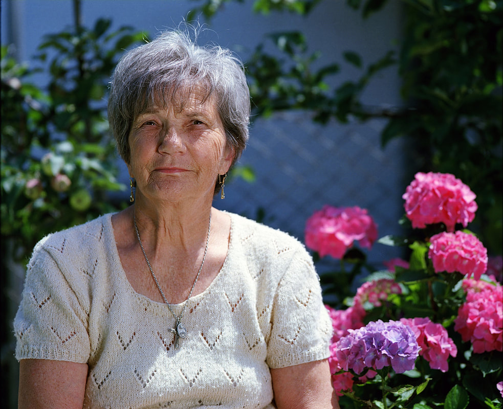older woman in garden, senior woman in garden, mature woman